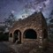 Riven Stone: Night view of the curious stone picnic shelter at Evans Lookout in the Blue Mountains.