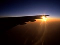aircraft wing and sunset