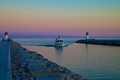 A boat enters the waterway to Frenchman's Bay at dusk.  Located in Pickering, Ontario, Canada.