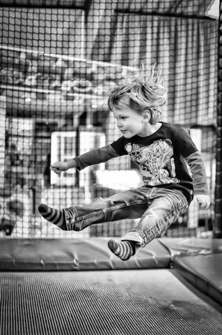 My son jumping on a trampoline