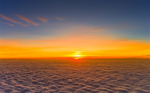 sunset over the clouds sea