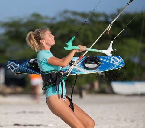 Pretty Female Kitesurfer in front of Armondo's Kite Shack Aruba