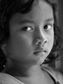 The Semais are an indigenous tribe from Malaysia. A young semai girl attending a weekly tuition in the village community hall. This weekly tuition is organised and taught by local community volunteers.