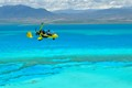 Gyrocopter above New Caledonia lagoon