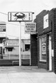 Taken in 1969 in Arlington Virginia.  It is the juxtaposition of the Crab Shop and the Massage Salon signs that make this photo humorous.