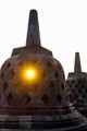 Sun flare through stupa at Borobudur