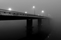 Bridge that disappears into some pretty thick fog.