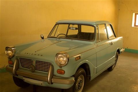 Classic blue car in garage