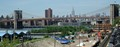 Towers of the Brooklyn Bridge framing Midtown Manhattan as seen across the East River from the Brooklyn Heights Promenade