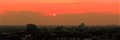 Orange sundown far above the town (Panorama)