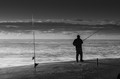 Surf fisherman at the beach.