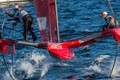 These trimaran based yachts use foils to raise the hull from the water. Once airborne they are very fast. On this day one capsized at over 35 knots!