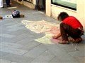 Men make street drawings