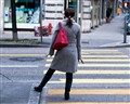 Woman Waiting to Cross the Street
