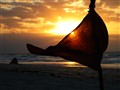 Red flag blown by the wind on a romantic sunset