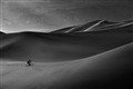 Photographer in the dunes