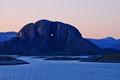 Torghatten Rock in midnight sun, Norway