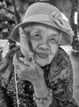 Old woman with her bird in Chiang Mai