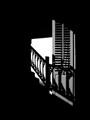 Shutter shadowed by stairway