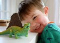 Visiting my daughter in Cape Cod. My grandson playing with his dinosaurs.