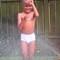 In the sprinkler on hot summer day