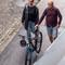 couple escorting a bike