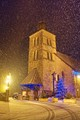 Church of Morillon on a snowy winter night.