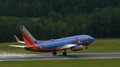 Southwest 737 taking off from RDU during a rain storm