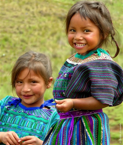 Two girls at a dedication ceremony for a new school in a rural village