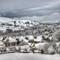 Village Snow: The village of Hathersage in the Derbyshire Peak District, UK.