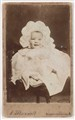 A carte-de-visite of a baby in a bonnet, by A. Maxwell
