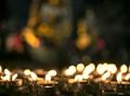 A candle-lit Buddha in Zhejiang's Yan Dang Shan monastery.