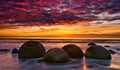 After several visits to Moeraki Boulders I was finally rewarded with this amazing Sunrise. Moeraki Boulders, South Island New Zealand.