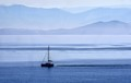 Sailing past.