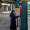 Nun at train station-20130901 - 3745