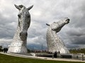 30 meter high stainless steel sculptures by  sculptor Andy  Scott  in central Scotland representing the working heavy horses of the past.