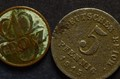 Two corroded coins