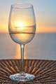 glass of white wine on ship terrace at sunset