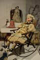 Doll Sitting in a Rocking Chair
