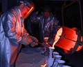 The annual Solstice Pour of hot liquid bronze at Caleco Foundry, December 22nd, 2011, Cody, Wyoming, USA.