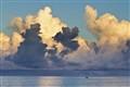 lone fisherman under golden cloud