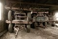 These worn and shabby farm wagon's are situated in a barn with the same characteristics. The low, grazing light enhances the desolate atmosphere ...