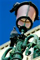 Pigeons on a street lamp