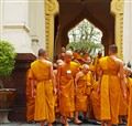 Novices leaving prayers at Wat Trimit temple, Bangkok