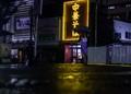 lady at night Iwakuni Train station