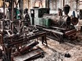 Store room off the running shed for steam locomotives at Sragi sugar mill, Java