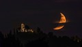 Moon setting behind Montevecchia Sanctuary, N Italy. Taken from home.