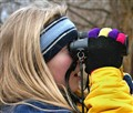girl and binoculars