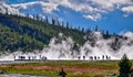 Steam rises next to Grand Prismatic Geyser in Yellowstone park