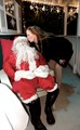 Santa getting a kiss.